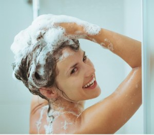 woman-washing-in-shower-smiling
