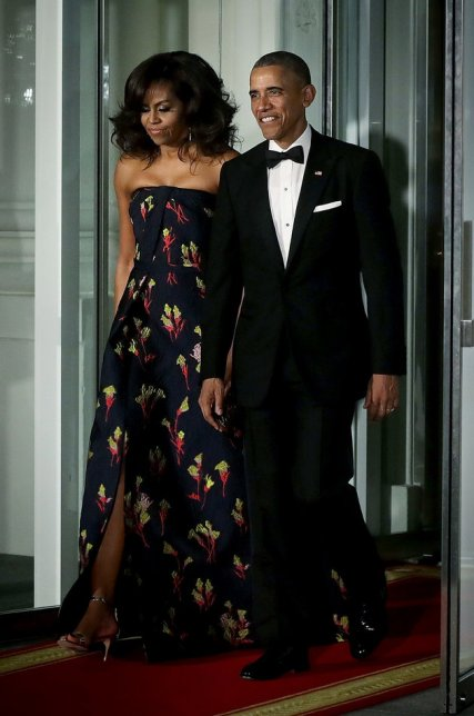 WASHINGTON, DC - MARCH 10: U.S. President Barack Obama (R) and first lady Michelle Obama (L) come out from the White House for the arrival of Canadian Prime Minister Justin Trudeau and his wife Sophie Grgoire Trudeau for a state dinner at the North Portico March 10, 2016 in Washington, DC. Prime Minister Trudeau is on an official visit to Washington. (Photo by Alex Wong/Getty Images)