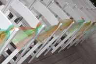 The wedding colors tied to the chairs.