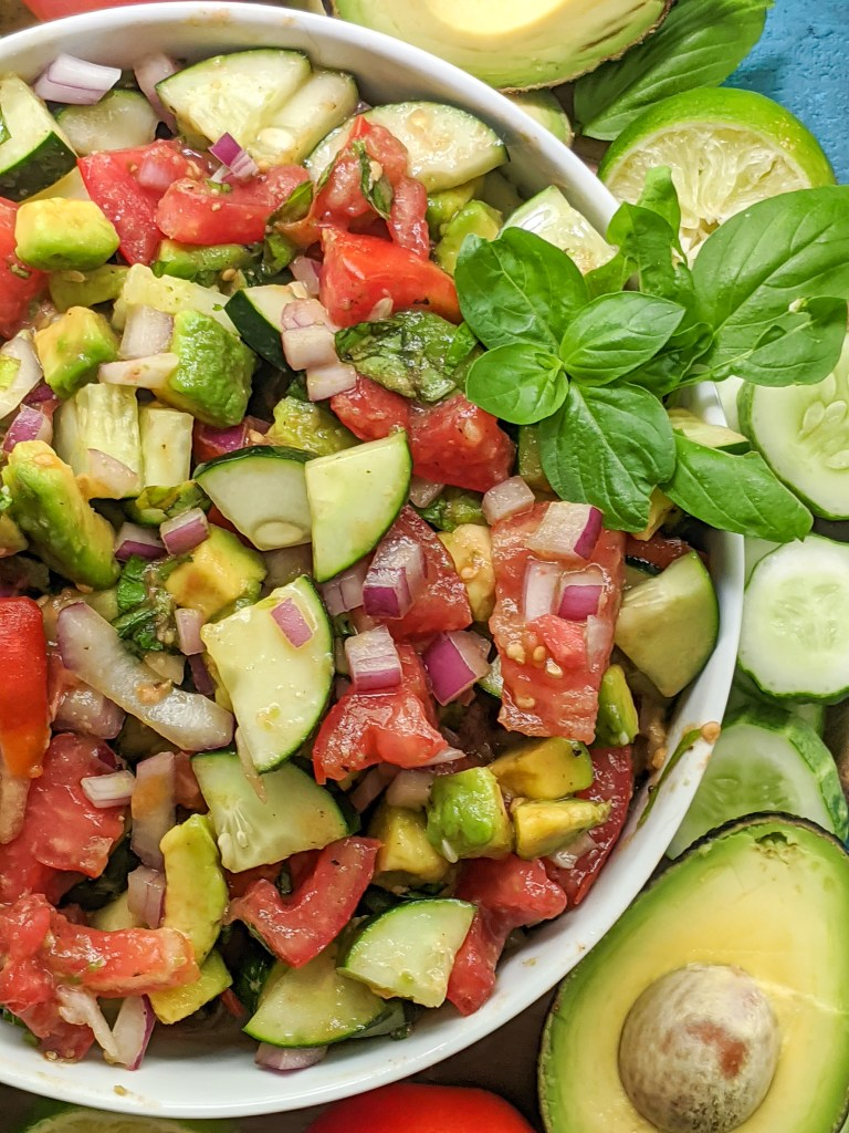Delicious side salad packed with fresh cucumbers, tomatoes, avocado, basil, and more! Paleo, Whole30, and Vegan friendly as well as dairy-free, gluten-free, and sugar-free. Easy, satisfying, and only 8 ingredients.