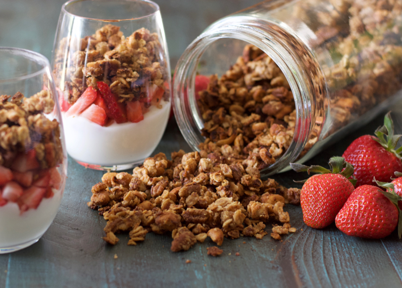 This Homemade Peanut Butter Granola is loaded with healthy ingredients, and comes together in just a few minutes! You can use this granola for healthy fruit parfaits, smoothie bowls, or a crunchy snack!