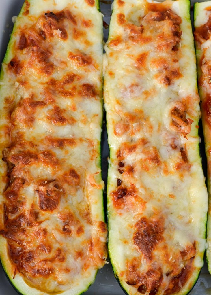 You only need five basic ingredients for these flavor-packed Air Fryer Pizza Zucchini Boats! Never miss a pizza night with this keto zucchini boat (only 2 net carbs apiece)!