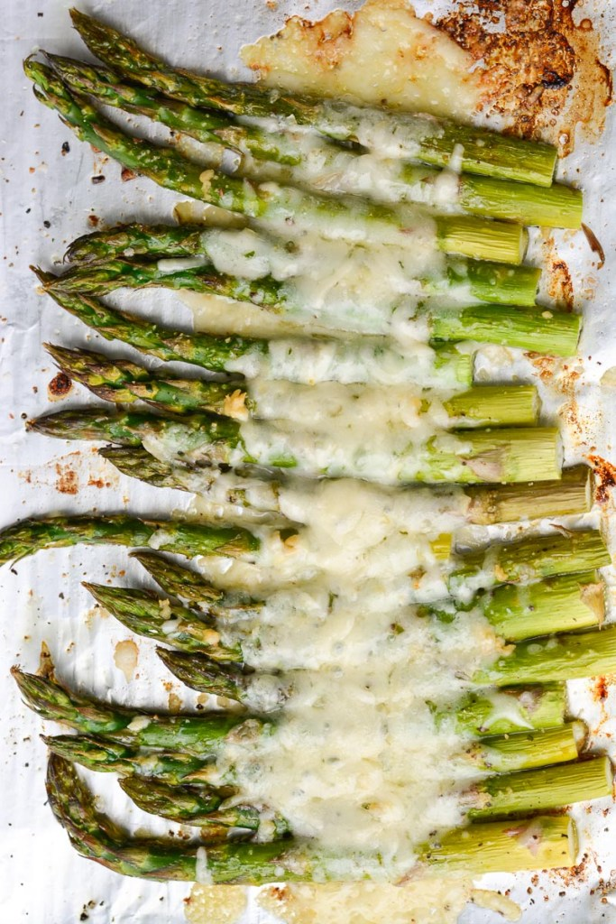 This low carb, keto-friendly Cheesy Roasted Asparagus is the perfect side dish! Prepare this easy recipe with just five basic ingredients!