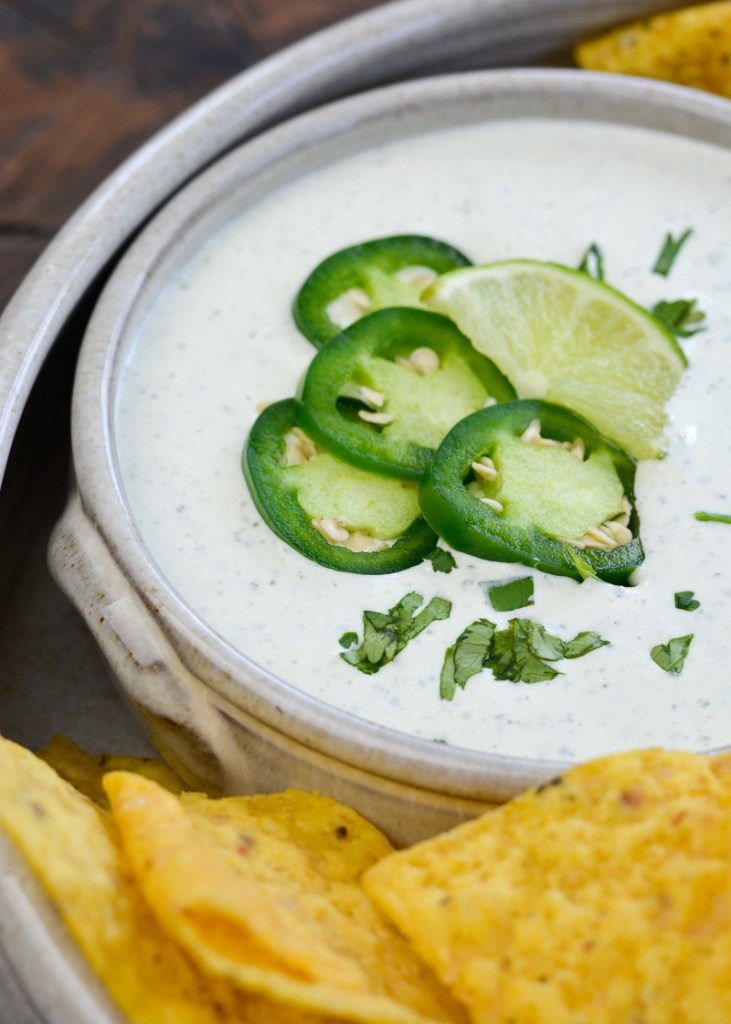 Chuy's Jalapeño Ranch dip is an all time favorite! This easy copycat recipe features fresh jalapeños, cilantro, and a bit of lime, it is great on tacos, salads or with crunchy tortilla chips!