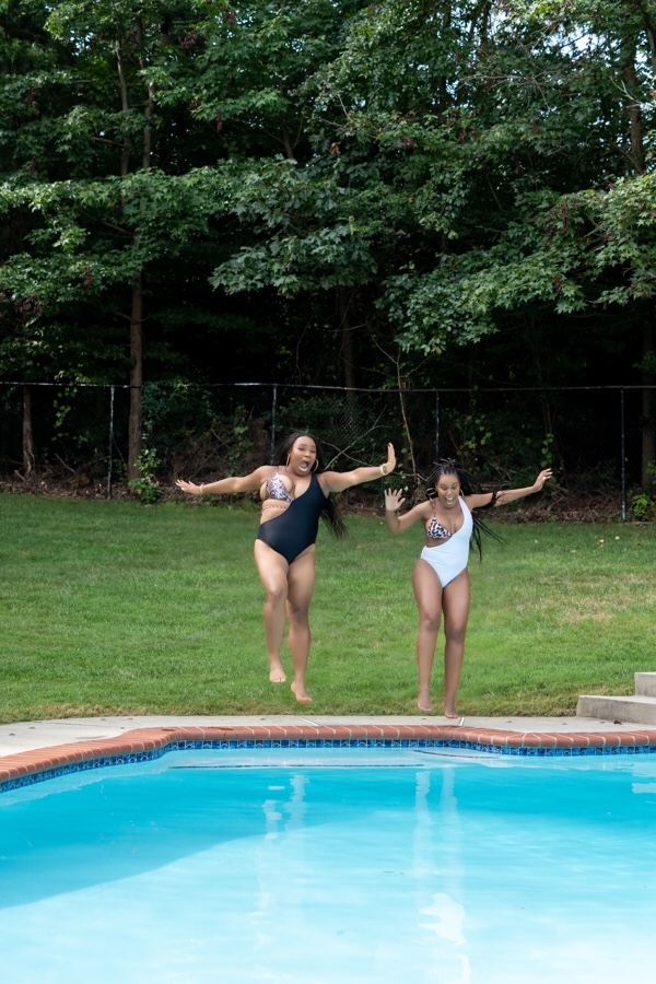 two women about to jump into the pool