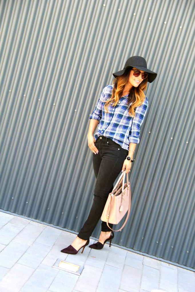 floppy hat, distressed denim, plaid top