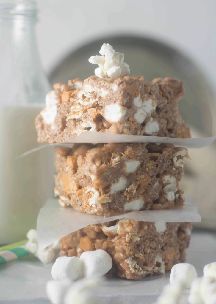Nutella butterscotch popcorn krispie treats are an over-the-top twist on a classic. No-bake but completely delicious, they're a perfect summer dessert.