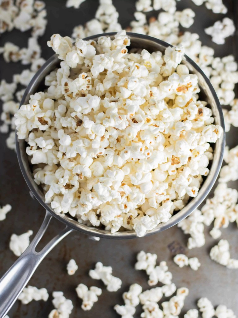 popcorn in a bowl before the caramel sauce has been added to make Nutella caramel corn