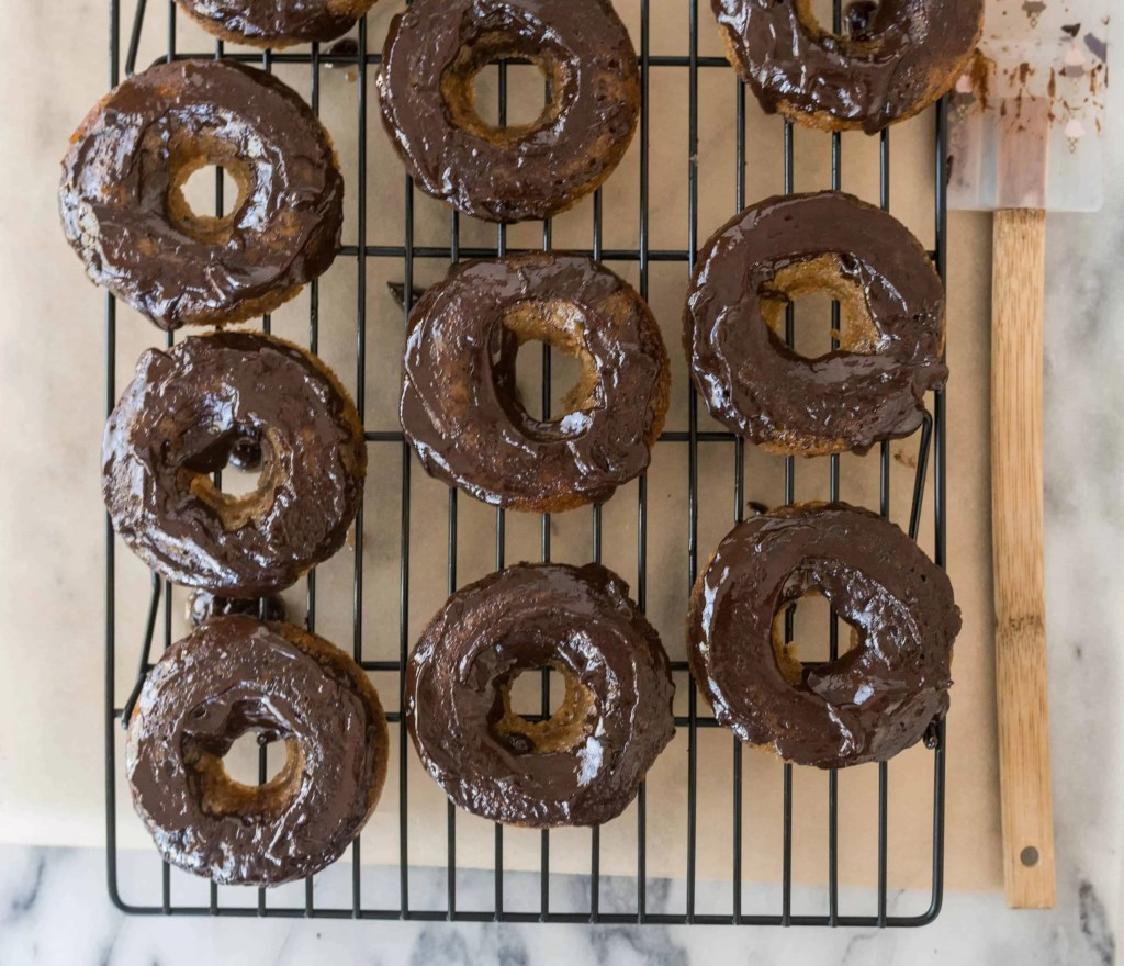 These gluten-free, refined sugar-free paleo chocoalte zucchini donuts are a healthy but indulgent breakfast, dessert, or snack. Find the recipe at itsybitsykitchen.com