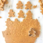 Homemade gluten-free peanut butter dog treats are a fun homemade cookie your fur babies will love. Cut them in the shape of gingerbread men for a fun Christmas gift! recipe via itsybitsykitchen.com #Christmas #dogtreats #homemade