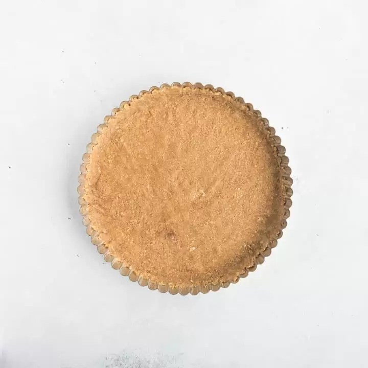 overhead shot of the lemon tart crust in the tart pan