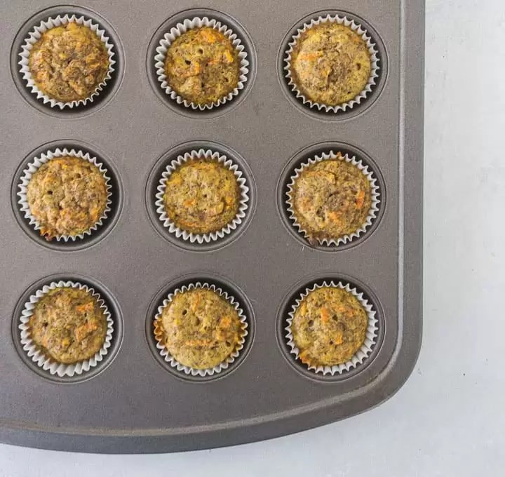 overhead view of mini carrot cake cupcakes for dogs (pupcakes) in their muffin tin after they come out of the oven