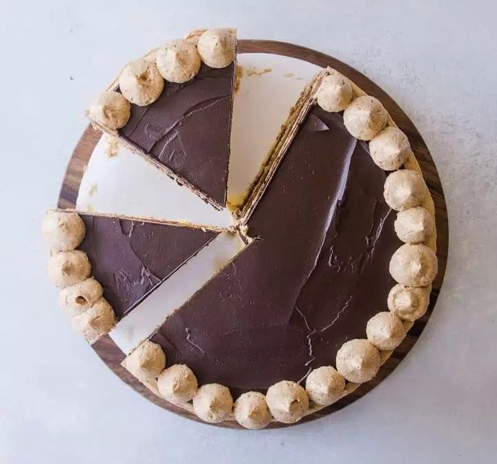 overhead shot of finished opera cake with two slices cut
