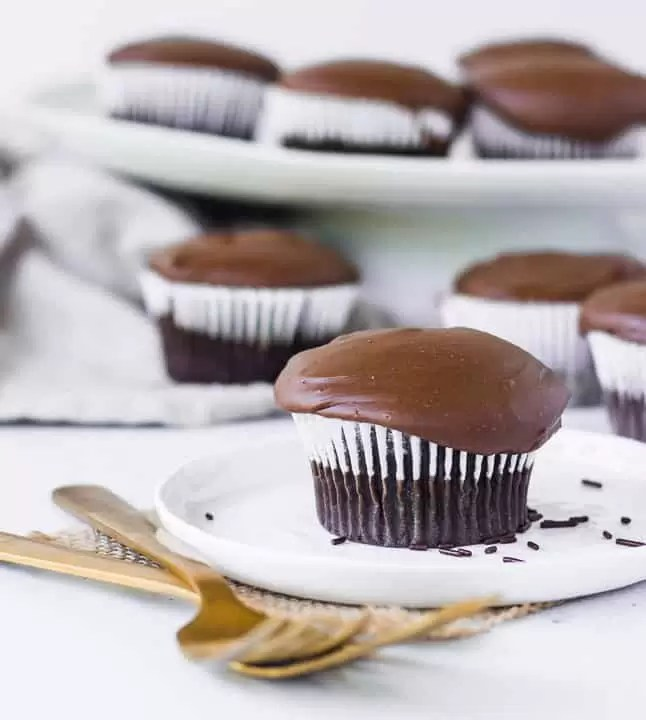 cupcake on a plate with more easy chocolate cupcakes in the background