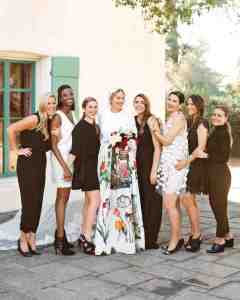 group of Bridesmaids with Bride, she is holding flowers