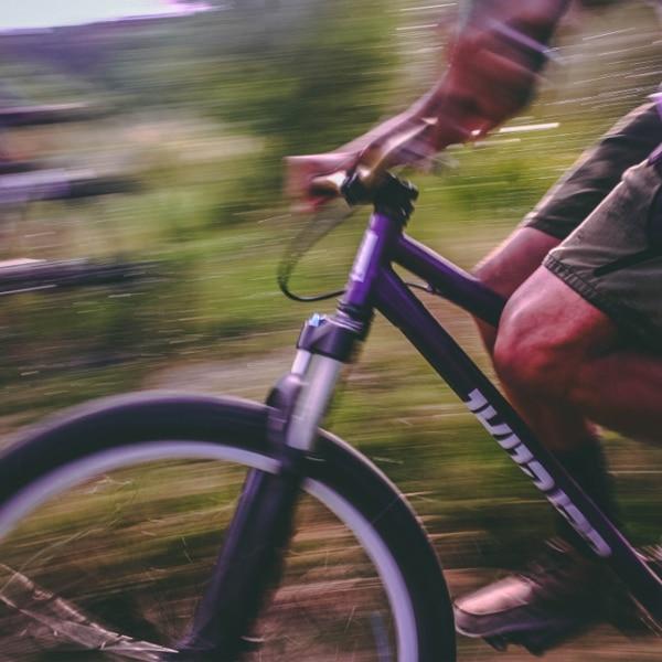 man riding bicycle closeup