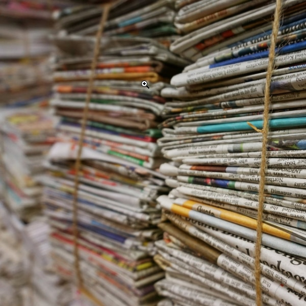 stacks of paper newspapers for recycling
