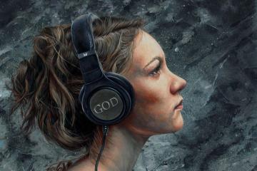 Woman listening to headphones that say GOD - Listen 4 by Brent Schreiber