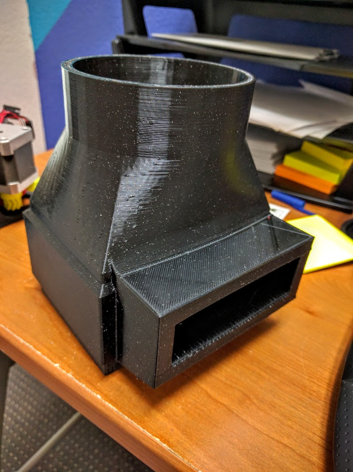Hose half of 3d printed dust collection shroud. notice the smooth finish and minimal support required