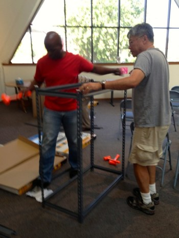Lester and Edward putting together new racks for the CE Closet.