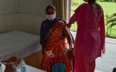 In the fight for health & safety rights, women tea workers are getting vaccinated