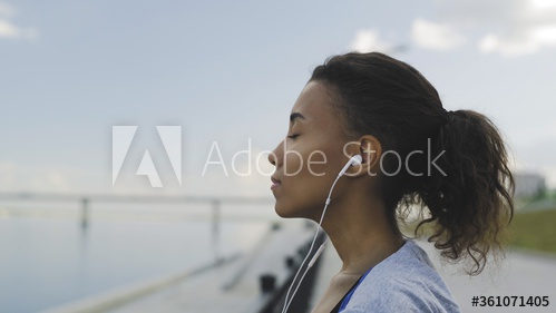 A woman listening to calming music.