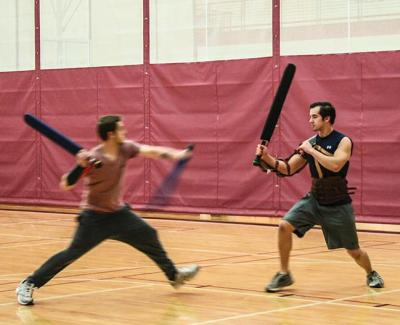 Zach Ziessler and Zach Moehn spar with /dagorhir swords, typically made with PVC or fiberglass pipes and hard foam Preface photo/MANDI STEFFEY