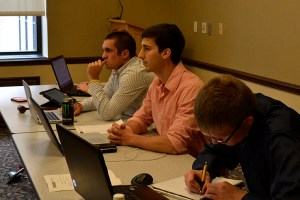 SGA President Lee Cohen (center) listens to the club's reasoning for the protest.