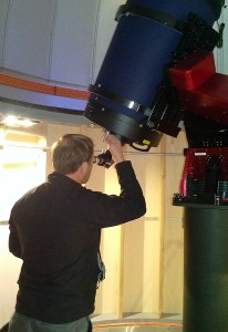 Hinnefeld looks through the telescope.