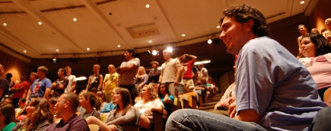 A full crowd looks on as hypnotist Chris Jones performs on campus, a previous event made possible by Titan Productions (Photo credit: www.iusb.edu)