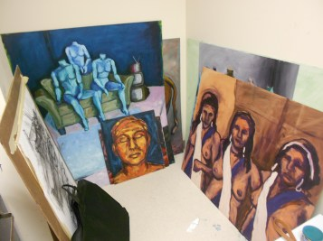 Paintings line the walls of drawing and painting major Katherine Corpe's private BFA studio. (Photo/Melissa Seyboldt)
