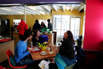 Michelle Hebron (left) enjoying lunch with friends at the Purple Porch Cafe. (Preface photo/Izza Jatala)