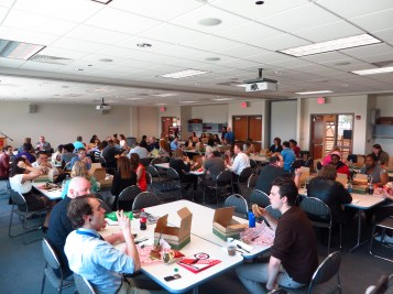 Presenters, Judges and Editors eating lunch in one of the meeting rooms in the SAC.