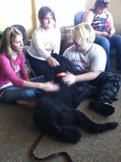 In October 2013, IUSB students relax with Paris, a certified therapy dog. (Preface Photo/TRICIA MCCANN)
