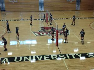 The lady Titans practice in the Student Activities Center as they gear up for their next game.