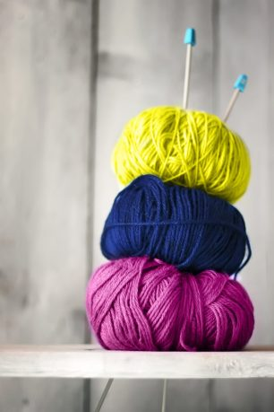 Photo of blue, purple and yellow balls of wool