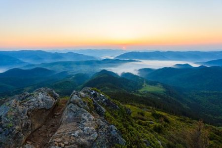 Morning mist at sunrise in the Carpathian mountains