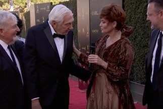 Carolyn Hennesy wears Ivey Abitz on the Emmys red carpet whilst interviewing Sid Krofft, Marty Krofft, and David Arquette
