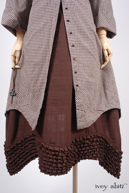 Look 24 - Spring 2018 Ivey Abitz Bespoke - Grasmere Duster Coat in Brownstone Banister Checked Cotton; Thatched Frock in Brick Wispy Plaid Voile, High Water Length; Clotaire Sash in Brownstone Banister Floral Silk.