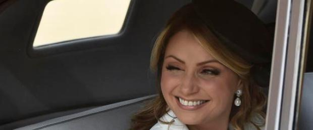 Angelica Rivera, the wife of Mexico's President Enrique Pena Nieto, smiles as she arrives to a ceremonial welcome at Horse Guards Parade in London Tuesday March 3, 2015. The President and his wife are on a three day state visit to Britain. (AP Photo/Toby Melville, Pool)