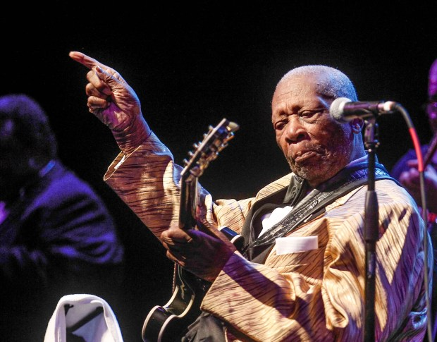 """In this April 4, 2014 photo, B.B King performs at the Peabody Opera House on April 4, 2014 in St. Louis, Mo.  Some St. Louis music fans are singing the blues after an erratic weekend performance by 88-year-old guitar legend B.B. King led to a stream of early departures and audience catcalls.  Concert-goers say King's rambling Friday night set at the Peabody Opera House included only a handful of complete songs amid musical snippets, long-winded soliloquies and a 15-minute sing-along of """"You Are My Sunshine.""""  (AP Photo/St. Louis Post-Dispatch, Sarah Conard)  EDWARDSVILLE INTELLIGENCER OUT; THE ALTON TELEGRAPH OUT"""