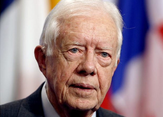 """(FILES): This October 25, 2007 file photo shows former US president Jimmy Carter speaking to the media after a meeting with United Nations Secretary General Ban Ki-Moon at United Nations headquarters in New York.  Carter plans to visit North Korea soon on a mission to secure the release of an American man serving eight years of hard labor there, Foreign Policy magazine said Monday, August 23, 2010.  """"Jimmy Carter is set to travel to North Korea very soon, according to two sources familiar with the former president's plans, in what they characterized as a private mission to free a US citizen imprisoned there,"""" the magazine said.   AFP PHOTO / Files / Stan HONDA (Photo credit should read STAN HONDA/AFP/Getty Images)   Original Filename: Was3345575.jpg"""