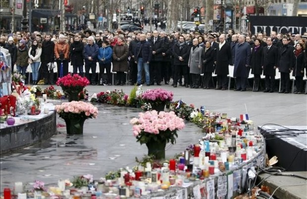 People attend a ceremony at Place de la Republique square to pay tribute to the victims of last year s shooting at the French satirical newspaper Charlie Hebdo in Paris France January 10 2016 France this week commemorates the victims of last year s Islamist militant attacks on satirical weekly Charlie Hebdo and a Jewish supermarket with eulogies memorial plaques and another cartoon lampooning religion REUTERS Charles Platiau