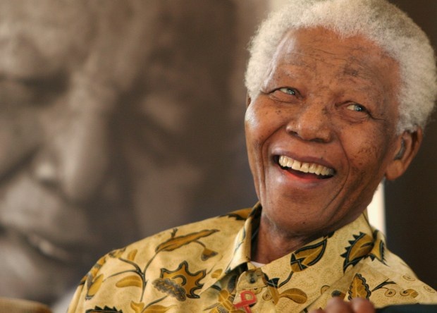 """Former South African President, Nelson Mandela, in a jovial mood at the Mandela Foundation in Johannesburg Wednesday, Dec. 7, 2005 where he met with the winner and runner-up of the local """" Idols"""" competition. The 87-year-old former political prisoner who became the country's first black president in 1994 remains a popular high profile figure since retiring from public life in recent years. (AP Photo/Denis Farrell)"""