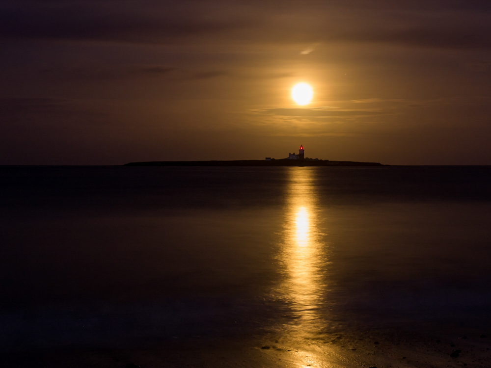 Golden Moon Light. The moon rised behind Coquet Island casting a golden light trail across the sea. Shooting the Moon can lead to many different photographs.