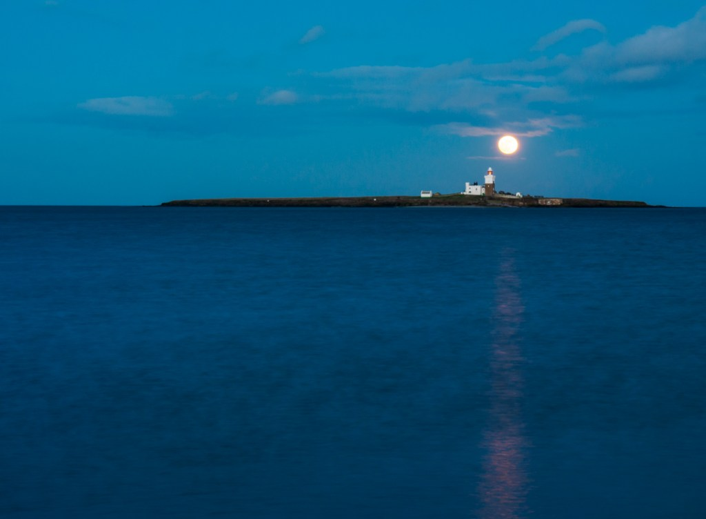 Moonrise over Coquet Island during the blue hour