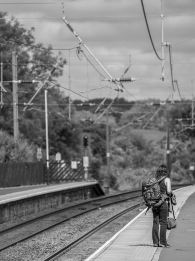 Girl waiting for a train.