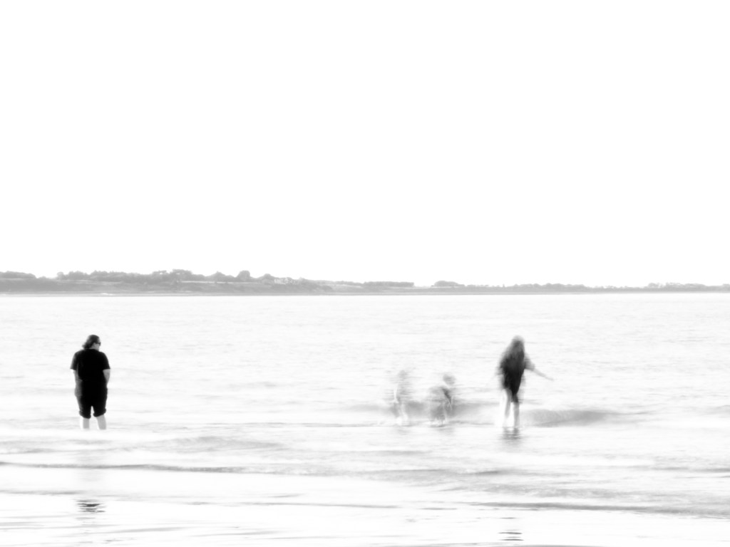 Meaningful Story. Of the three categories, this is the most challenging. Abstract image of children playing in the sea while and older person watches on.
