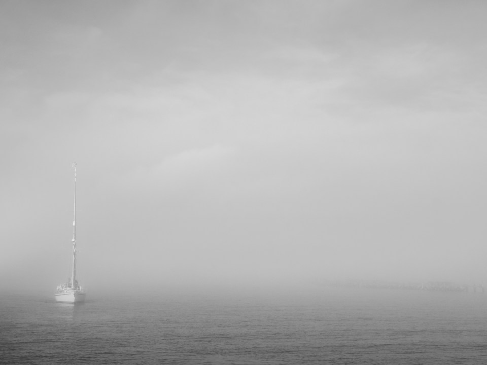 Yacht appearing out of the fog