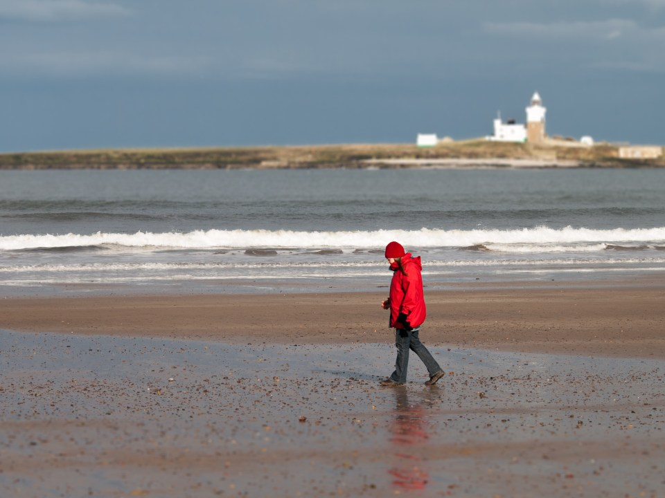 My wife walking on the beach, shot with my old Olympus E-510 in 2011